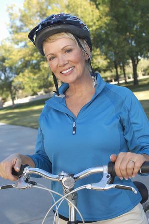 Senior woman on bicycle, portrait Stock Photo - 3812639