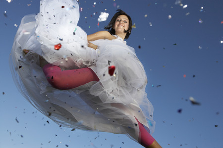 Portrait of young woman in wedding dress jumping Stock Photo - 3812299