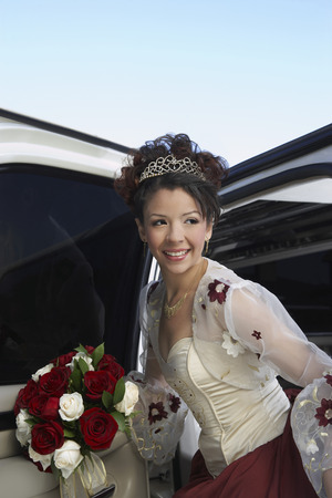 Bride with bouquet getting out of limousine Stock Photo - 3811143