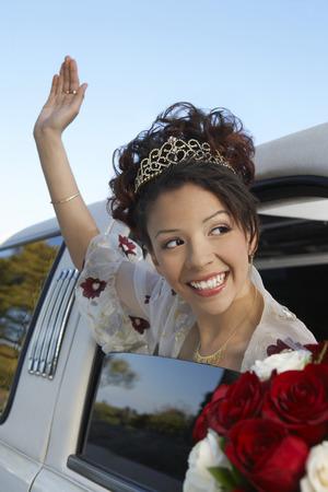 Bride waving from car window Stock Photo - 3812253