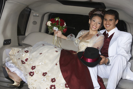 mixed marriage: Bride and groom in limousine