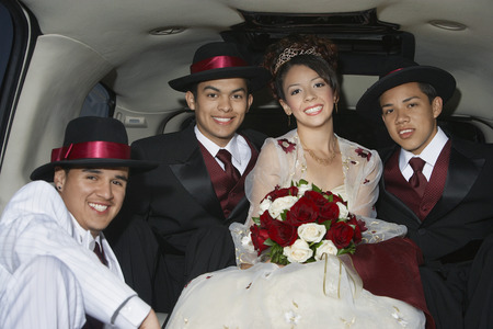 Bride, groom and best men in limousine Stock Photo - 3812577