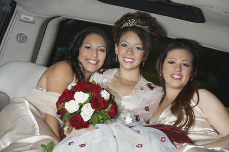 Bride with bridesmaids in limousine Stock Photo - 3812599