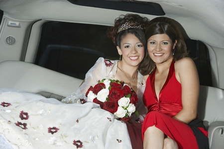 mixed marriage: Bride with mother in limousine LANG_EVOIMAGES