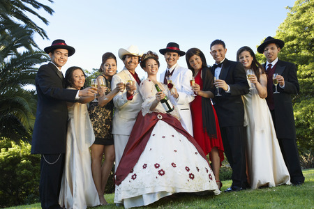 Group portrait of wedding couple and guests in garden Stock Photo - 3812635