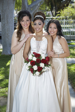 Portrait of bride with bridesmaids in garden Stock Photo - 3812325