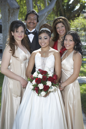 Portrait of bride with parents and bridesmaids in garden Stock Photo - 3812239