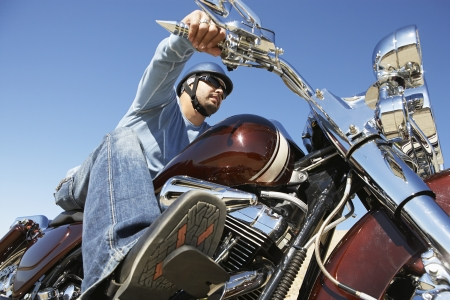 Biker riding motorcycle, low angle view Stock Photo - 3812480