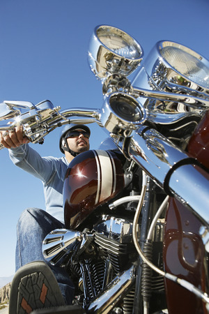 Biker riding motorcycle, low angle view Stock Photo - 3812492