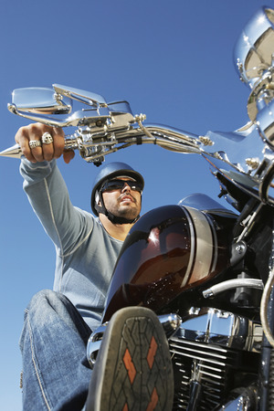 Biker riding motorcycle, low angle view Stock Photo - 3812418