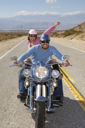 Bikers riding on desert road Stock Photo - 3812678
