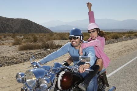Bikers riding on desert road Stock Photo - 3812673