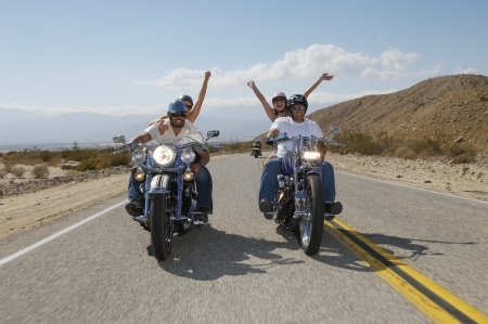 Bikers riding on desert road Stock Photo - 3812629