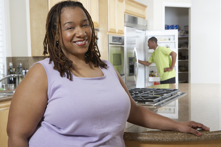 man long hair: Woman standing in kitchen, smiling, portrait