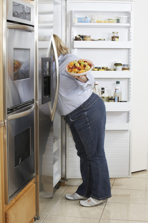 Woman looking into fridge, side view Stock Photo - 3812194