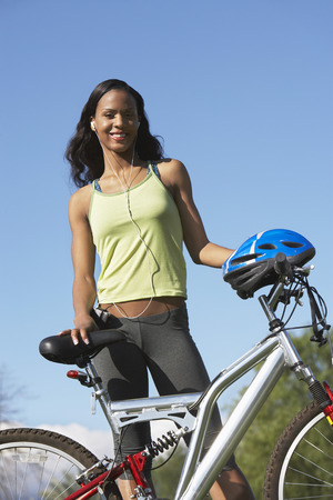 Young woman with bicycle, outdoors, portrait Stock Photo - 3812203