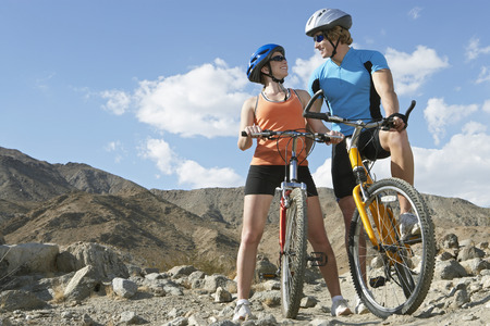 Young couple on bicycles in mountains Stock Photo - 3812537
