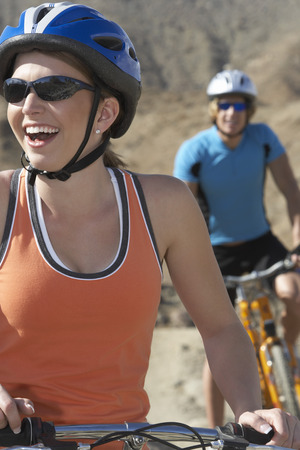 Young couple cycling in mountains Stock Photo - 3811231