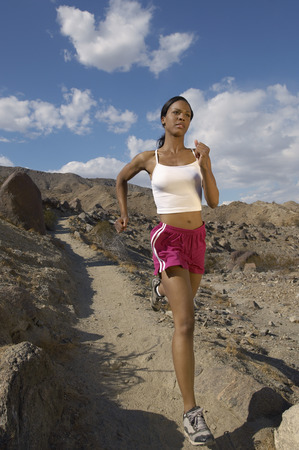 Young woman jogging in mountains Stock Photo - 3812609