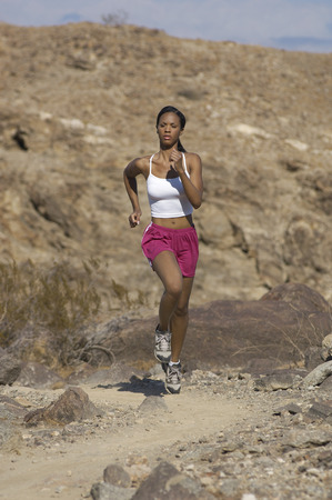 Young woman jogging in mountains Stock Photo - 3812420