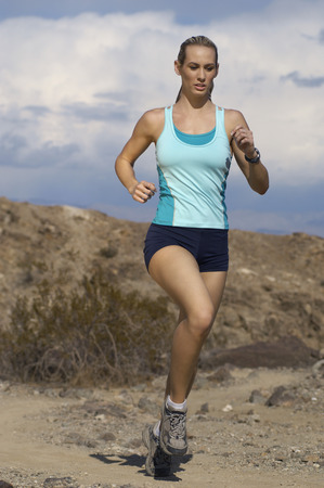 Young woman jogging in mountains Stock Photo - 3812260