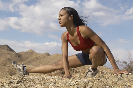 Female jogger stretching in mountains Stock Photo - 3812473