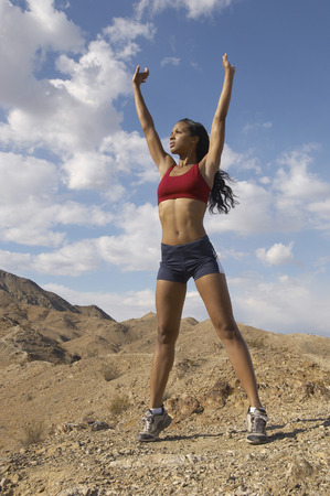 Female jogger stretching in mountains Stock Photo - 3812632
