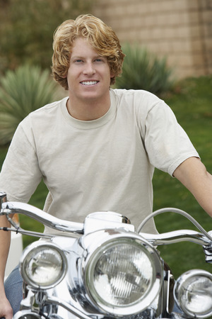 Portrait of man on motorbike Stock Photo - 3812285