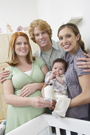 Portrait of two women, man and baby (1-6 months) in room Stock Photo - 3812380