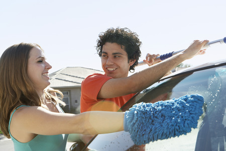 Young couple washing car Stock Photo - 3811213