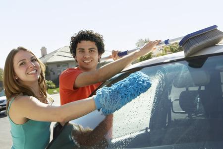 wash: Young couple washing car