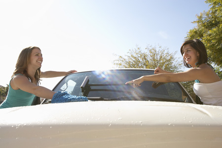 Two young women washing car Stock Photo - 3811140