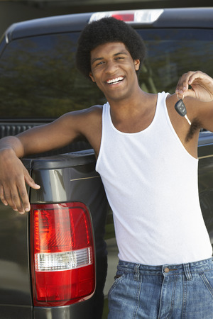 Young man holding car key standing by pick up truck, portrait Stock Photo - 3813223