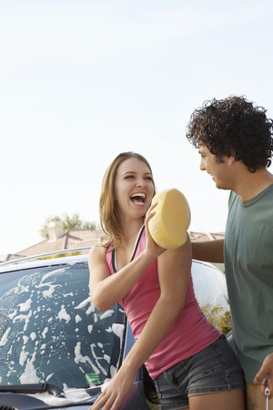 Young couple washing car outdoors Stock Photo - 3811167