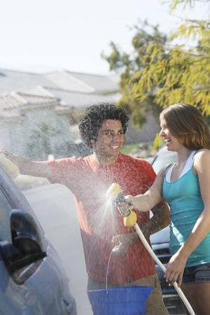 Young couple washing car Stock Photo - 3811193