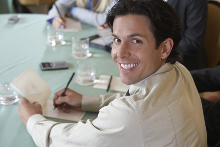 Business man writing at conference meeting, portrait Stock Photo - 3813140