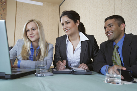 Business colleagues using laptop at conference meeting Stock Photo - 3813142