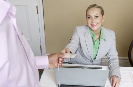 distributing: Receptionist distributing name tags