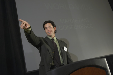 Mid adult man pointing during presentation at conference Stock Photo - 3813164