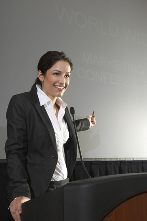 lecturing: Mid adult woman lecturing
