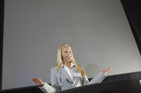 Young woman during presentation at conference Stock Photo - 3811261