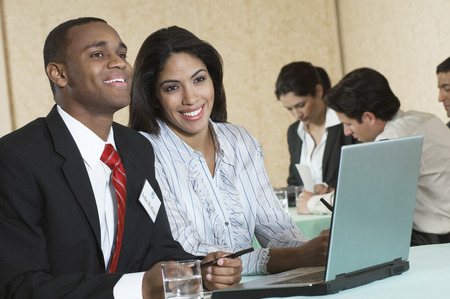 Business man and woman using laptop at conference meeting Stock Photo - 3813217