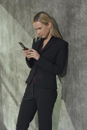 Businesswoman text messaging Stock Photo - 3813204