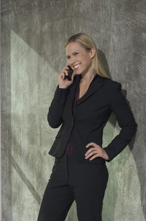 Businesswoman talking on mobile phone Stock Photo - 3813149