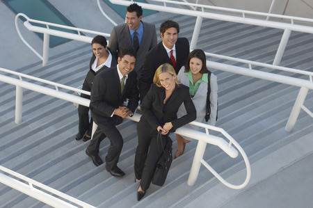 Group portrait of business people on stairs, elevated view Stock Photo - 3813212