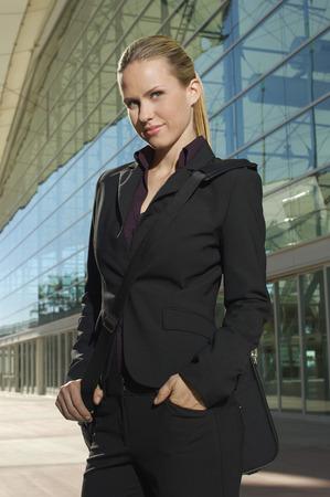 Portrait of businesswoman outside office building Stock Photo - 3813175