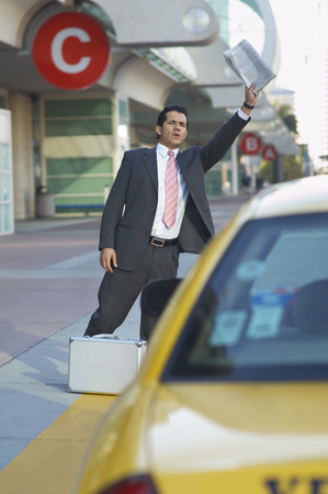 Businessman hailing taxi Stock Photo - 3811245
