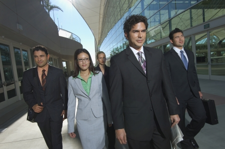 Group of business people walking past office building Stock Photo - 3813188