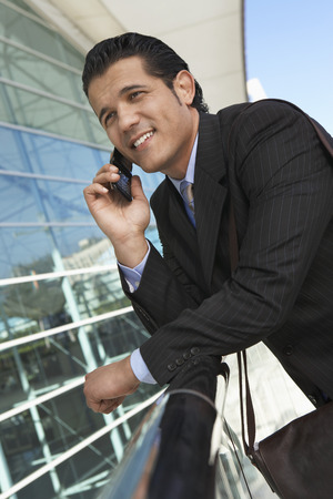 Businessman using mobile phone outside office building Stock Photo - 3811440
