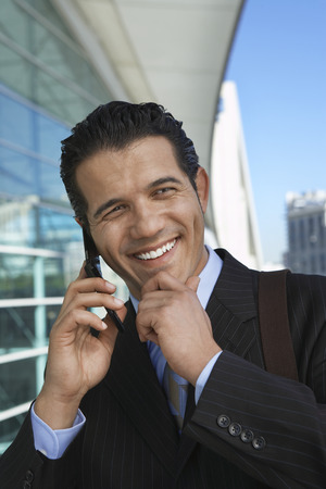 Businessman using mobile phone outside office building Stock Photo - 3811466
